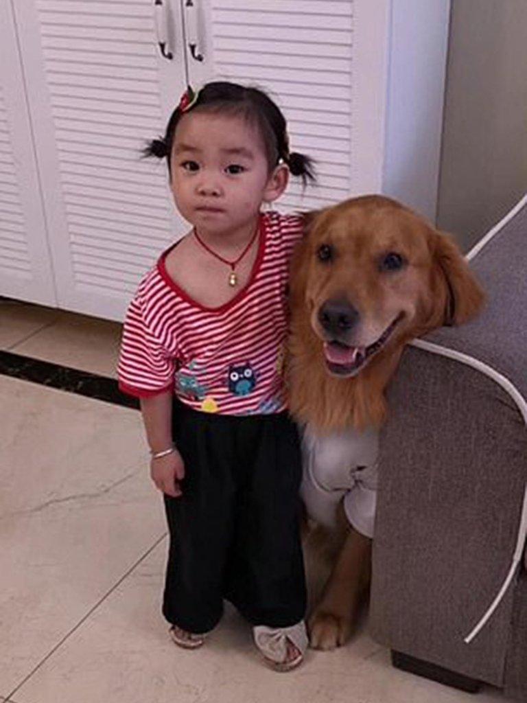 niña y mascota